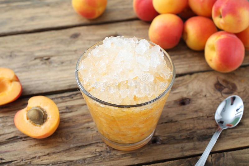 Apricot frozen smoothie. On rustic background stock images