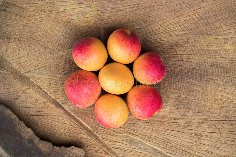 Apricot fruit. Fresh apricots on a wooden background. Close up flat lay photography royalty free stock image