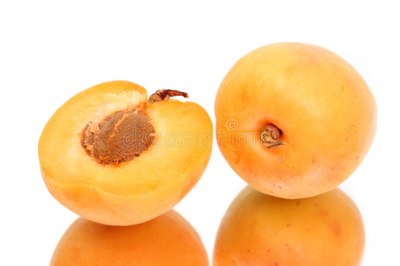 Apricot with halves. With reflection stock photo
