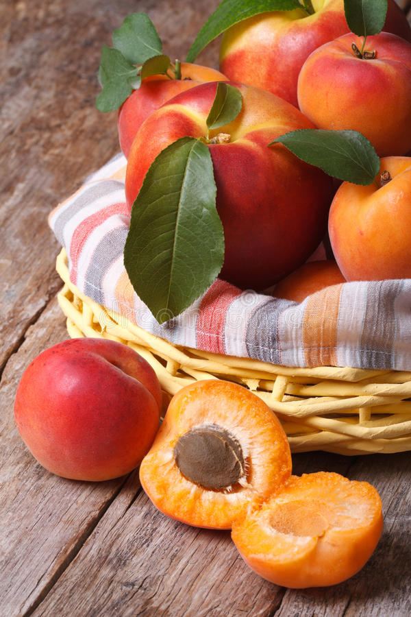 Apricot halves closeup on background baskets of fruit. On the table. vertical stock image