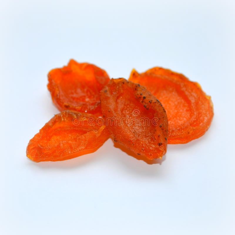 Apricot halves, dried apricots cooking. Dried apricots. Technology of preparation of candied apricots stock photography