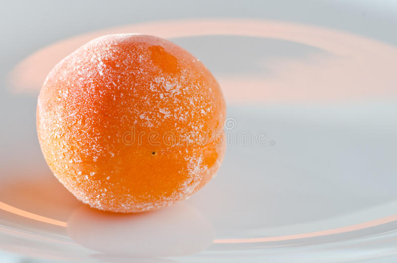 Apricot in hoarfrost. Frozen apricot frost on a platter stock photography