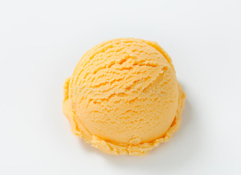 Apricot ice cream. Scoop of apricot ice cream royalty free stock image