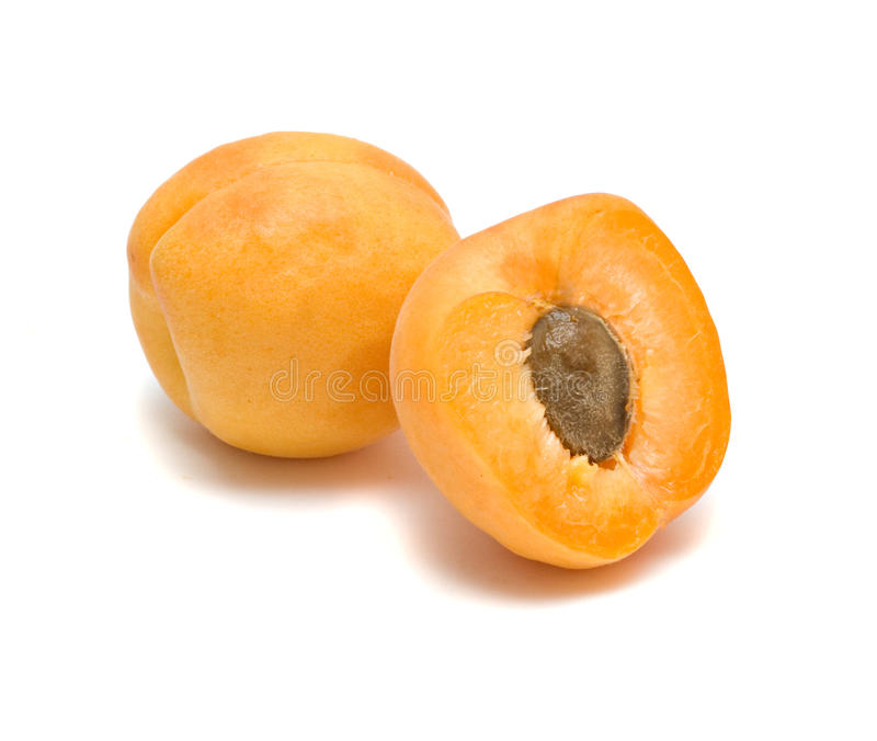 Apricot and its section. Isolated on white background stock image