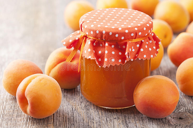 Apricot jam and fresh fruits stock photos