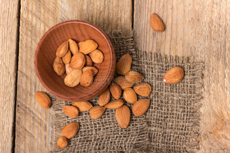 Apricot kernels. On the wooden board stock image