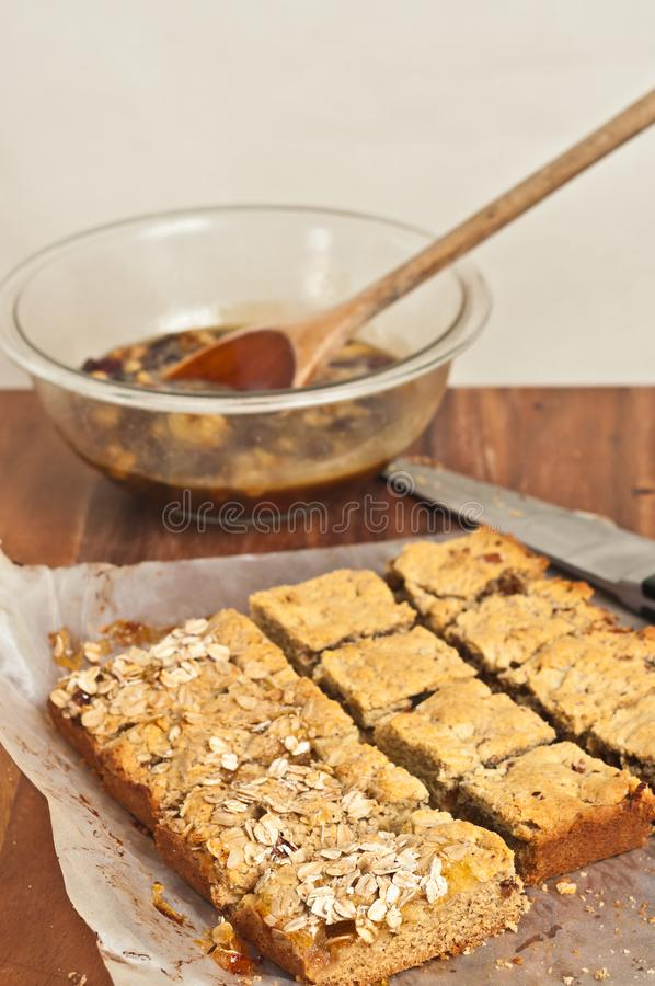 Apricot pecan bars cooling on parchment paper royalty free stock photos