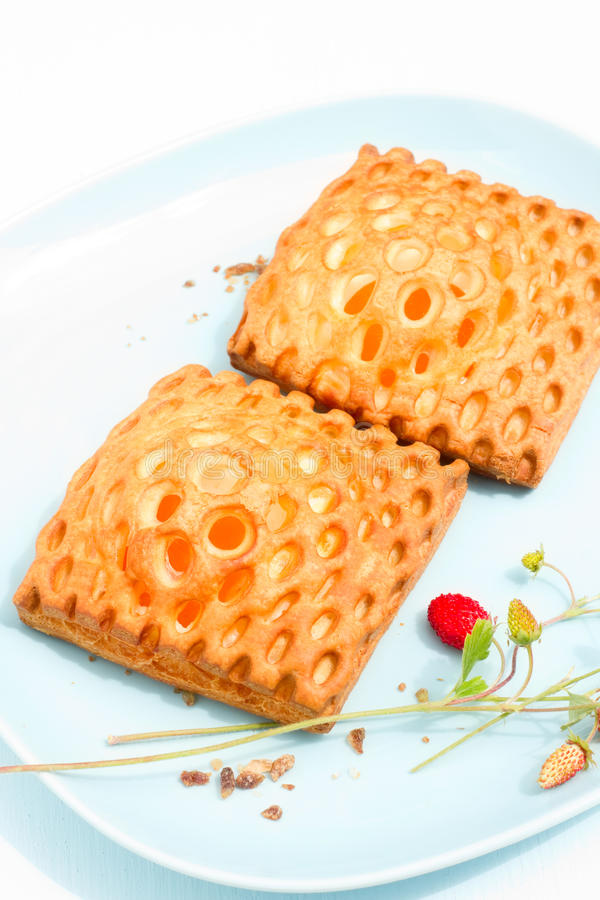 Apricot puff pastries. Two glazed lattice danish puff pastries filled with apricot royalty free stock photography