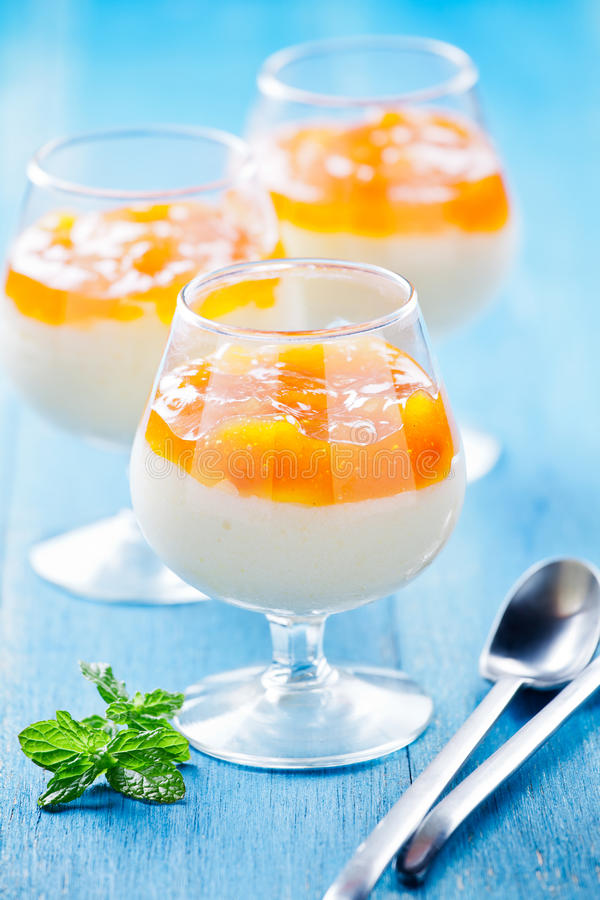 Apricot And Vanilla Cream. Close up photograph of a glass of vanilla cream stock photo