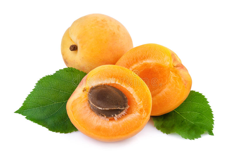 Apricot whole and half fruits on white stock photo