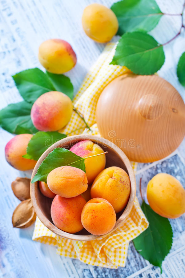 Apricots. Fresh apricots in the wooden bowl stock images