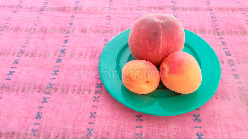 Apricots With Peach in a Plate. Apricots With Peach Served in a Plate royalty free stock photos