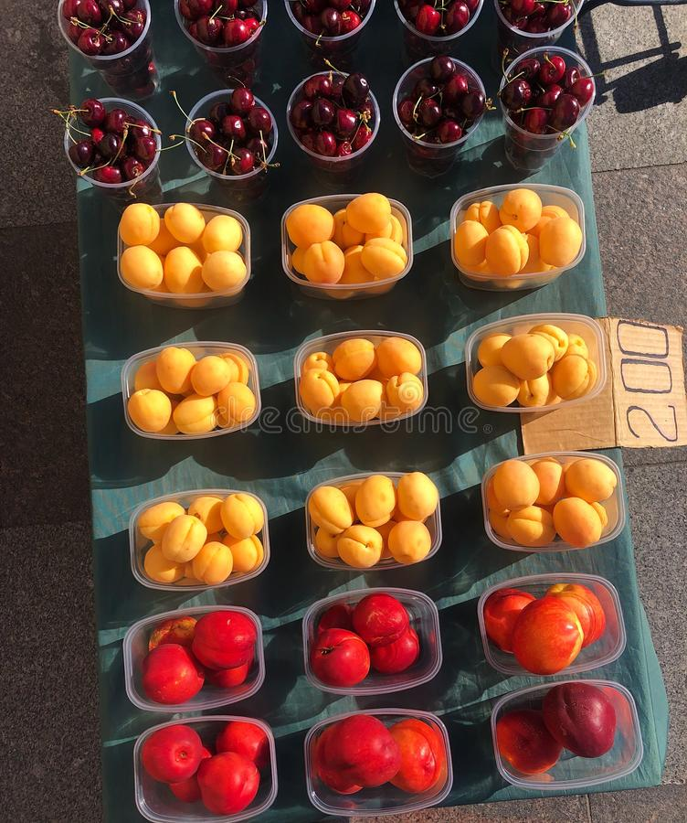 Apricots peaches and cherries on the market stock images