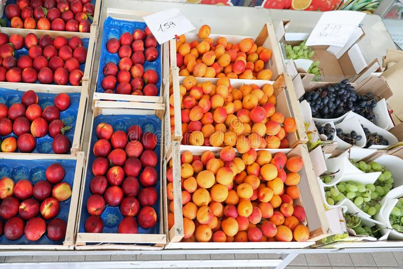 apricots peaches and grapes for sale royalty free stock photo