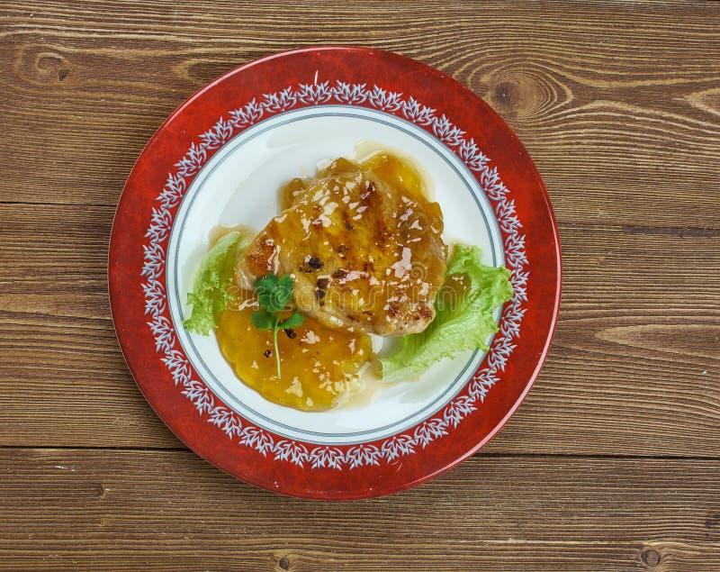 Aprikos Dijon Pork Chops arkivfoton