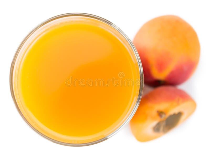 Aprikosen-Saft lokalisiert auf Weiß stockfoto