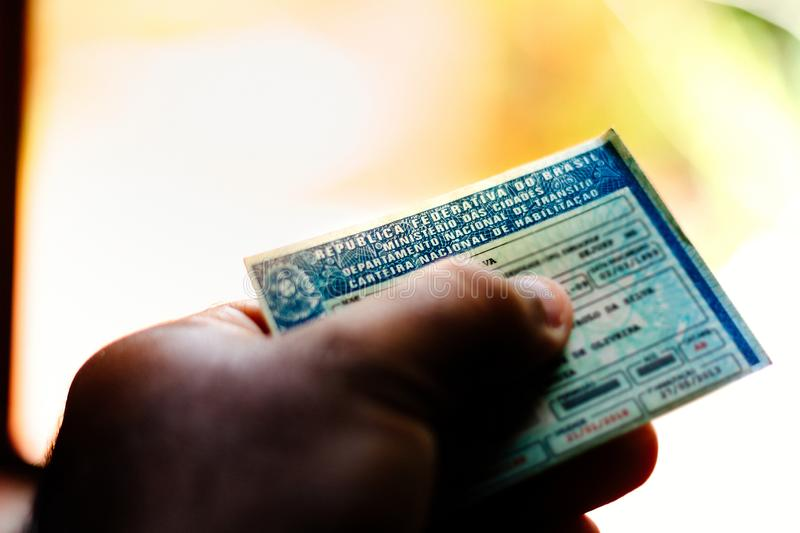 April 5, 2019, Brazil. Man holds National Driver's License (CNH). Official document of Brazil, which attests the ability of a. Citizen to drive land vehicles stock photography