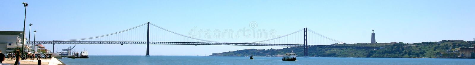 25 of april bridge ponte 25 de abril over the river tejo, seen from belem, lisbon, portugal. On a sunny day royalty free stock image
