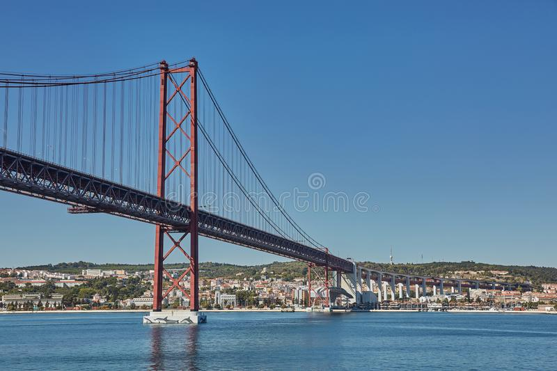 The 25 April bridge Ponte 25 de Abril is a steel suspension bridge located in Lisbon, Portugal, crossing the Tagus river. It is royalty free stock photos