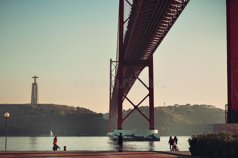 25 April bridge. The 25 April bridge is a steel suspension bridge located in Lisbon, Portugal, crossing the Tagus river stock image