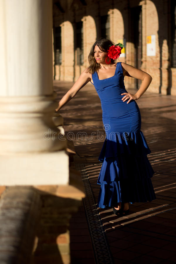 The blue dressed woman in the sun. Beautiful woman Andalusian towards the april fair stock image