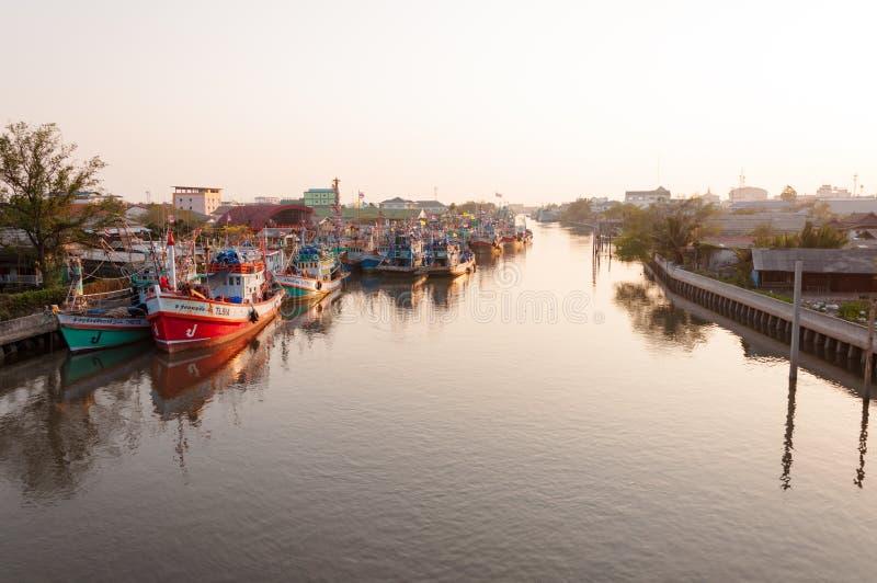 APRIL 11,2016 - Fishing vessels in Mahachai estuary fishing village in evening, Samutprakarn, Thailand royalty free stock photos