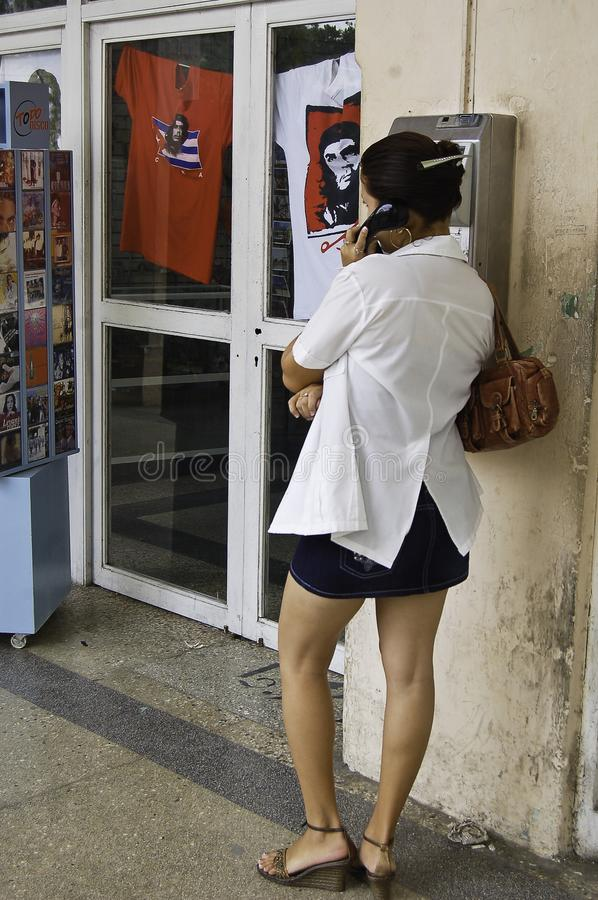 Girl who calls with the Che Guevara`s Shirt behind stock photography