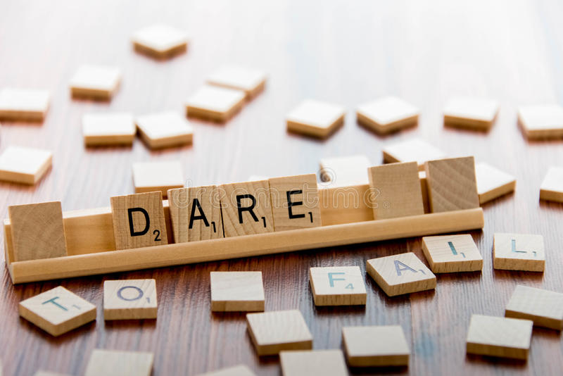 April 4, 2015: Houston, TX, USA - Scrabble tiles spelling DARE royalty free stock images
