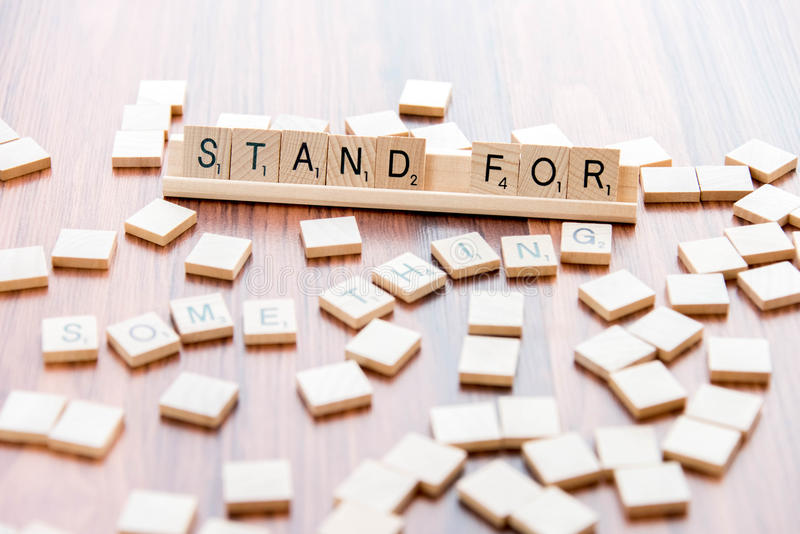 April 4, 2015: Houston, TX, USA - Scrabble tiles spelling Stand royalty free stock images
