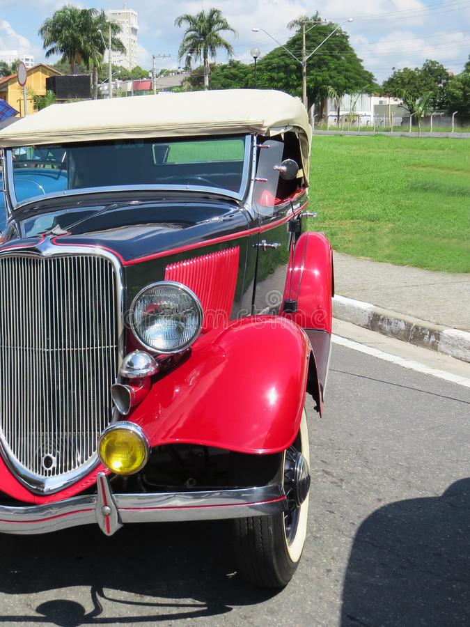 April 08, 2018, Jacareí, Sao Paulo Brazil, close-up of old red Ford car front, restored in antique car exhibition. royalty free stock photo