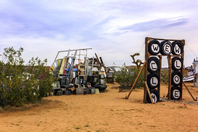 April 7, 2017 - Joshua Tree, California, USA: Noah Purifoy`s Outdoor Desert Art Museum in Joshua Tree, California, United States. View on the Welcome sign near royalty free stock image