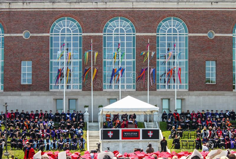 April 24 2015 Middletown USA - Lin-Manuel Miranda giving commencement address at Wesleyan University in outdoor ceremony with. Flags waving and surrounded by stock images