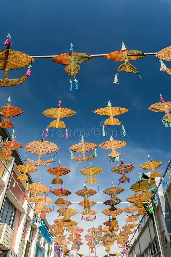 """April 19, 2016 - Petaling Jaya, Malaysia : The beautiful and colorful """"Wau"""" or kites hanged the middle of the buildings. Of Petaling Jaya street of royalty free stock images"""