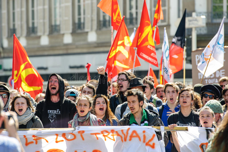 April protest against Labour reforms in France. STRASBOURG, FRANCE - APR 20, 2016: Crowd yelling as hundreds of people demonstrate as part of nationwide day of royalty free stock photo