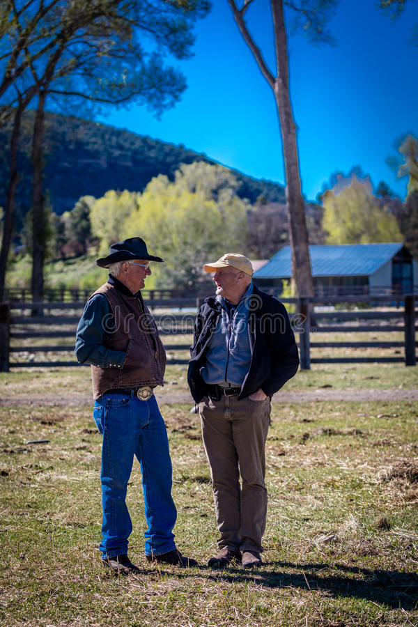 APRIL 22, 2017, RIDGWAY COLORADO: Ranch owner Vince Kotny tells a story to Ridgway resident, Patrick O'Leary on his Centennial Ran stock image