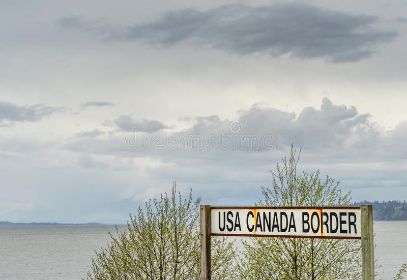 April 14, 2019 - Surrey, British Columbia: BNRR Railway USA Canada border sign. April 14, 2019 - Surrey, British Columbia: BNRR Railway USA Canada border sign royalty free stock image