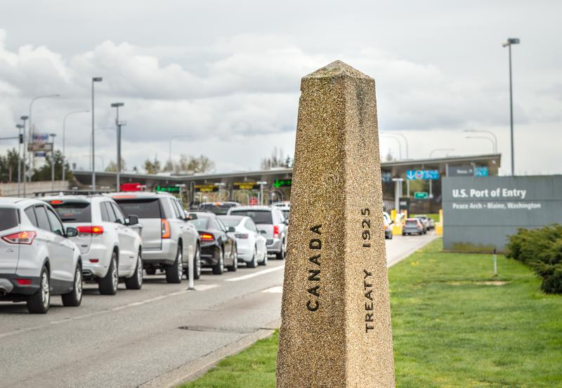 April 14, 2019 - Surrey, British Columbia: Internationl Boundary Monument marker at Canada-USA border. April 14, 2019 - Surrey, British Columbia: Internationl royalty free stock image