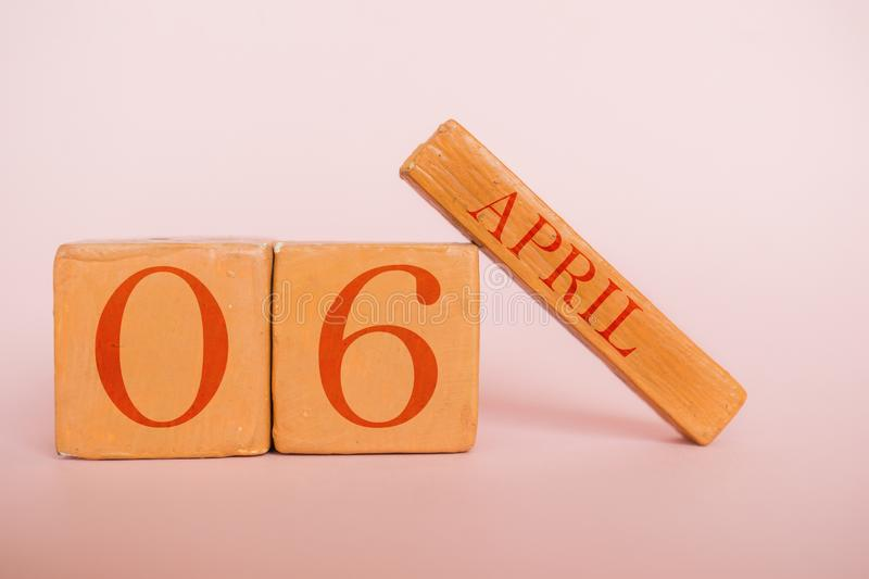 April 6th. Day 6 of month, handmade wood calendar  on modern color background. spring month, day of the year concept. April 6th. Day 6 of month, handmade wood stock photo