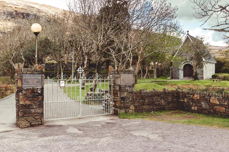 Entrance gates to Saint Finbarr`s Oratory, a chapel built on an island in Gougane Barra, a very serene and beautiful place in coun. April 30th, 2018, Gougane stock photos