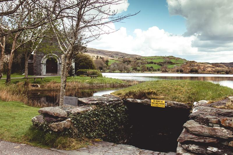 Holy well of Saint Finbarr`s Oratory, a chapel built on an island in Gougane Barra, a very serene and beautiful place in county Co. April 30th, 2018, Gougane royalty free stock photography