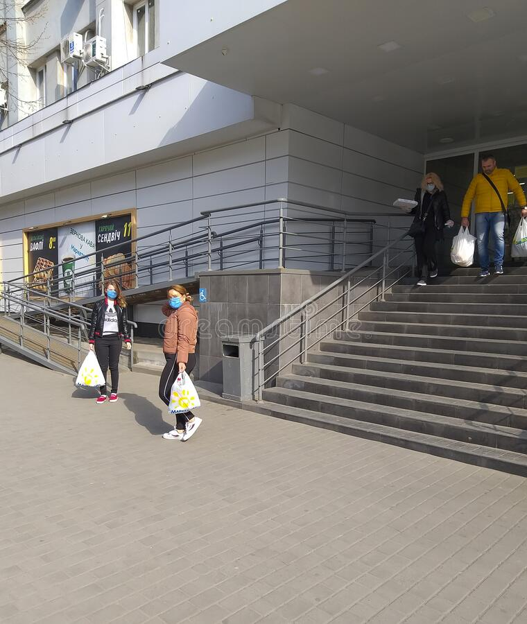 April 1, 2020, Ukraine, Poltava masked people near the store. April 1, 2020, Ukraine  Poltava masked people near the store royalty free stock images