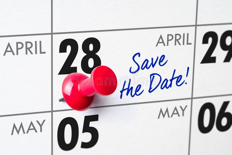 April 28. Wall calendar with a red pin - April 28 stock images
