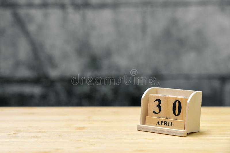 April 30 wooden calendar on vintage wood abstract background. using as background Universal day concept with copy space for your stock image