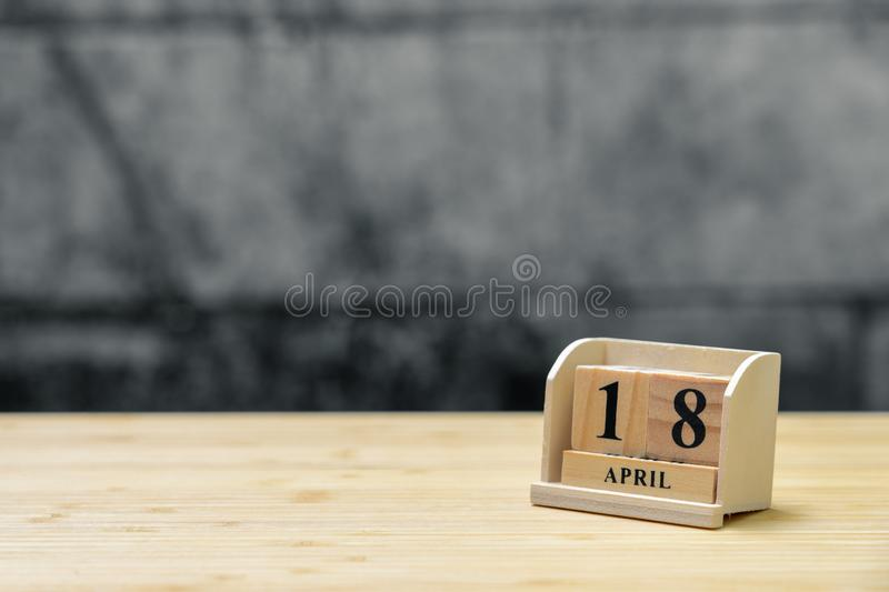 April 18 wooden calendar on vintage wood abstract background. using as background Universal day concept with copy space for your stock photography