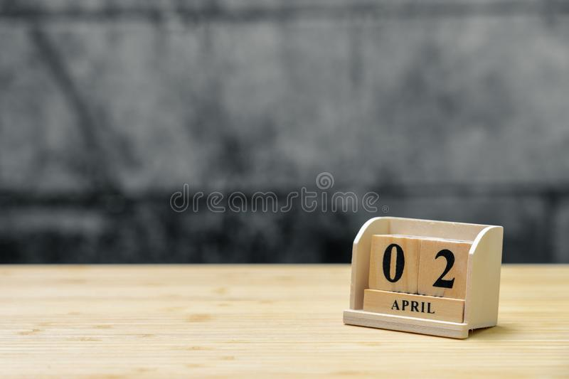 April 2 wooden calendar on vintage wood abstract background. using as background Universal day concept with copy space for your royalty free stock image