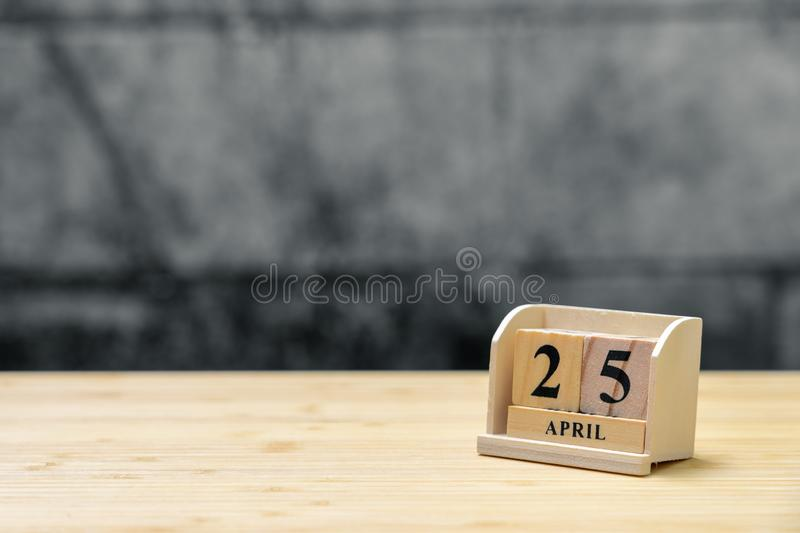 April 25 wooden calendar on vintage wood abstract background. using as background Universal day concept with copy space for your royalty free stock photography