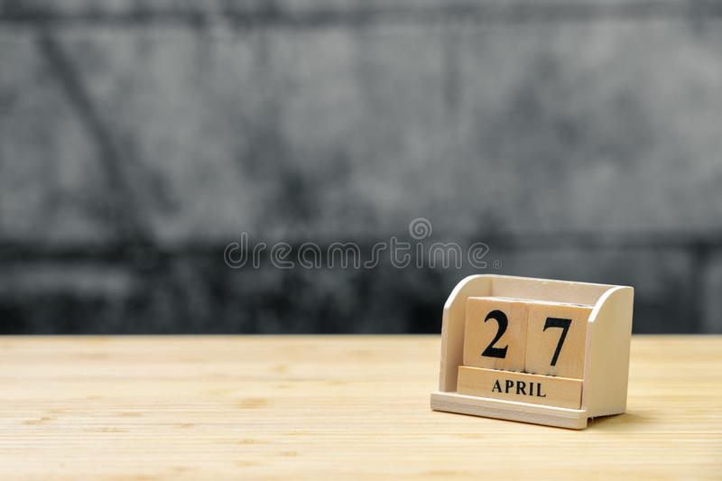 April 27 wooden calendar on vintage wood abstract background. using as background Universal day concept with copy space for your royalty free stock images