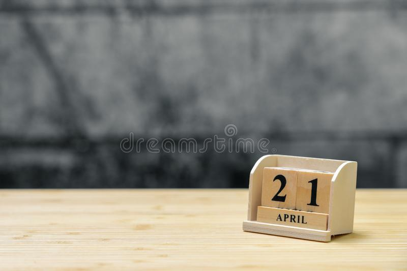 April 21 wooden calendar on vintage wood abstract background. using as background Universal day concept with copy space for your stock image