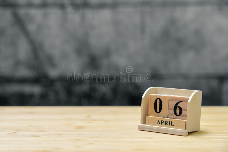 April 6 wooden calendar on vintage wood abstract background. using as background Universal day concept with copy space for your stock photos