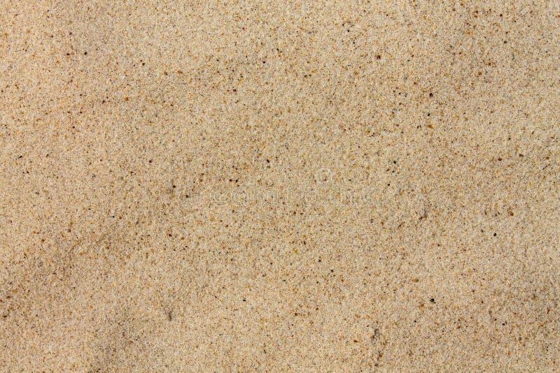 Aproximação de quartzo de textura. Areia na praia imagem de stock royalty free